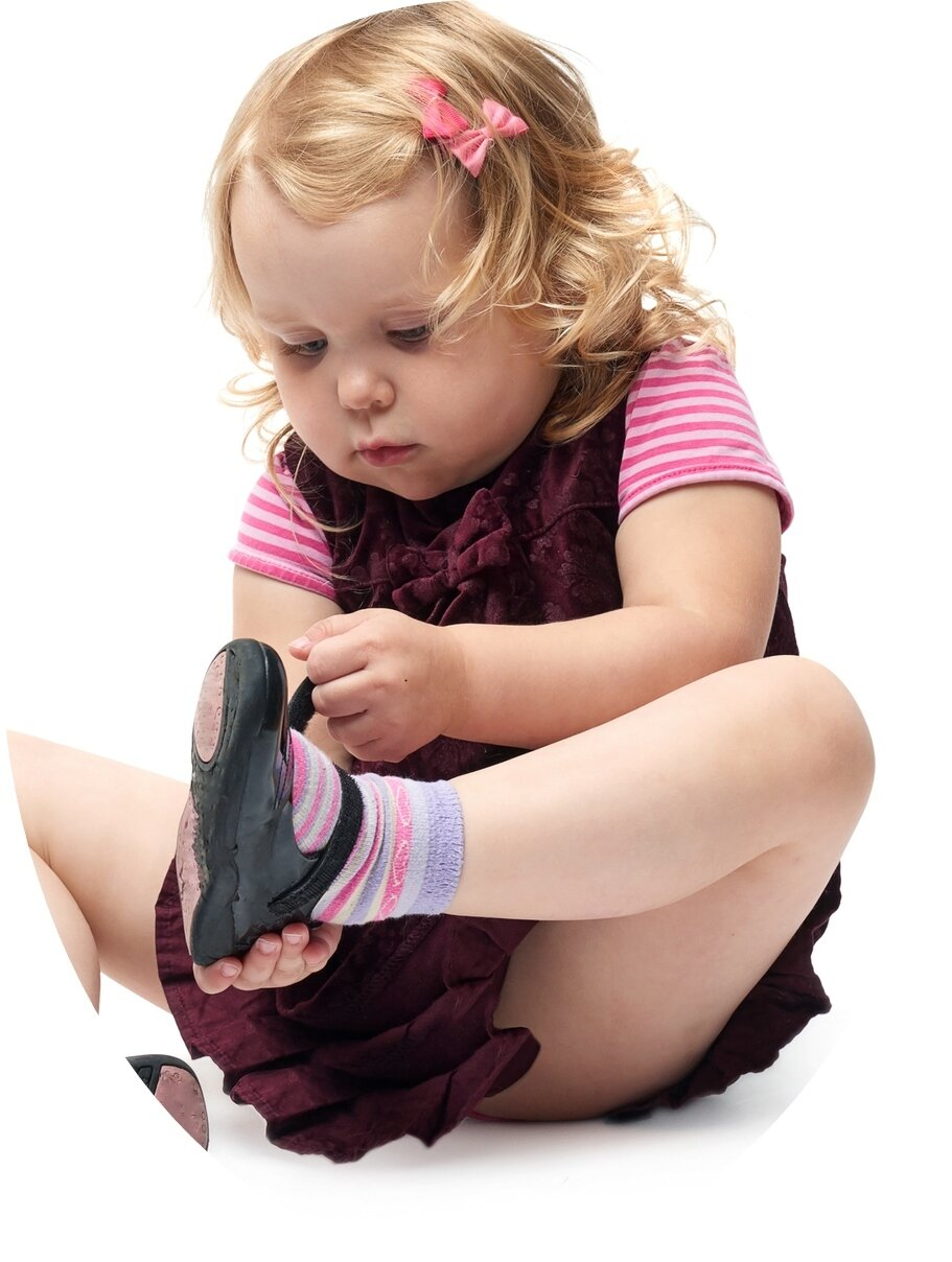 toddler putting on shoe