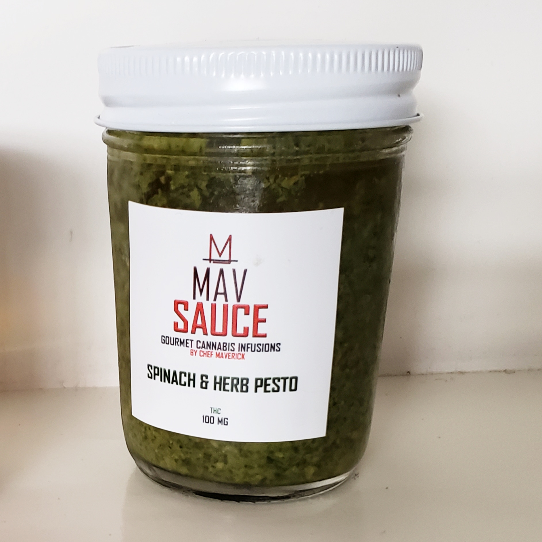 SPINACH & HERB PESTO   CHEF MAVERICK'S SPECIAL RECIPE INFUSED PESTO COMES PACKED WITH TONS OF FLAVOR. MADE WITH SPINACH, BASIL, PARSLEY, GARLIC, OLIVE OIL, PARMESAN CHEESE ALONG WITH A SPECIAL BLEND OF SPICES AND SEASONINGS.   AVAILABLE DOSES:  8 OZ - 100 MG   GLUTEN FREE, SOY FREE