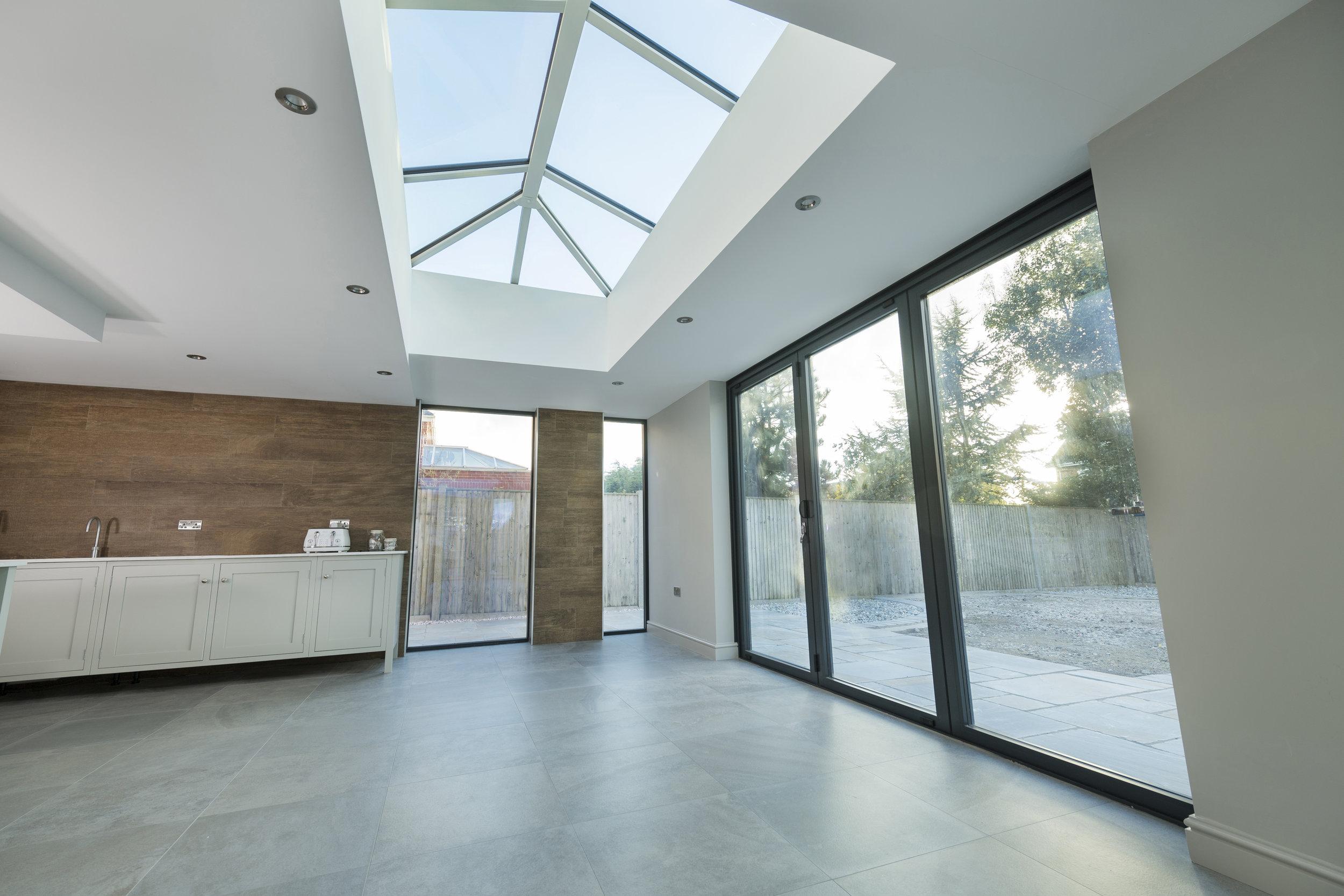 The purpose designed Stratus aluminium lantern roof system is discreet yet stylish