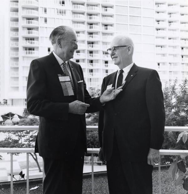 A.Z. Baker, 1955-56 RI president, admires a newly minted Paul Harris Fellow medallion at the 1969 Rotary Convention in Honolulu, Hawaii, USA.