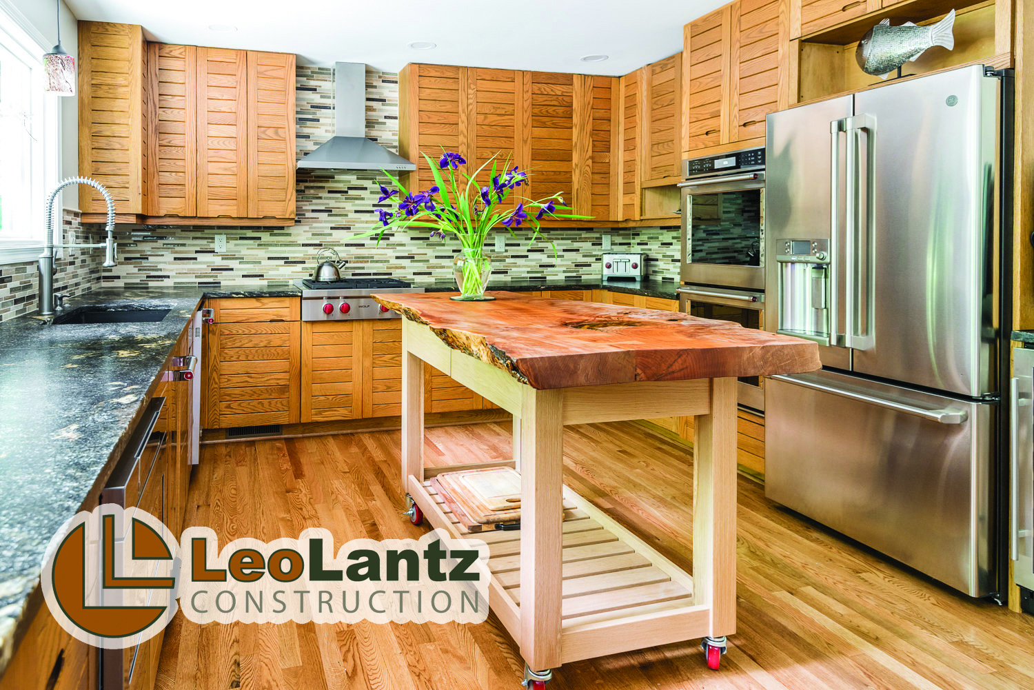 Residential Kitchen Under $100,000 - Leo Lantz ConstructionHerman Allen Plumbing, Heating & CoolingMorris Tile DistributorsPella Windows & Doors