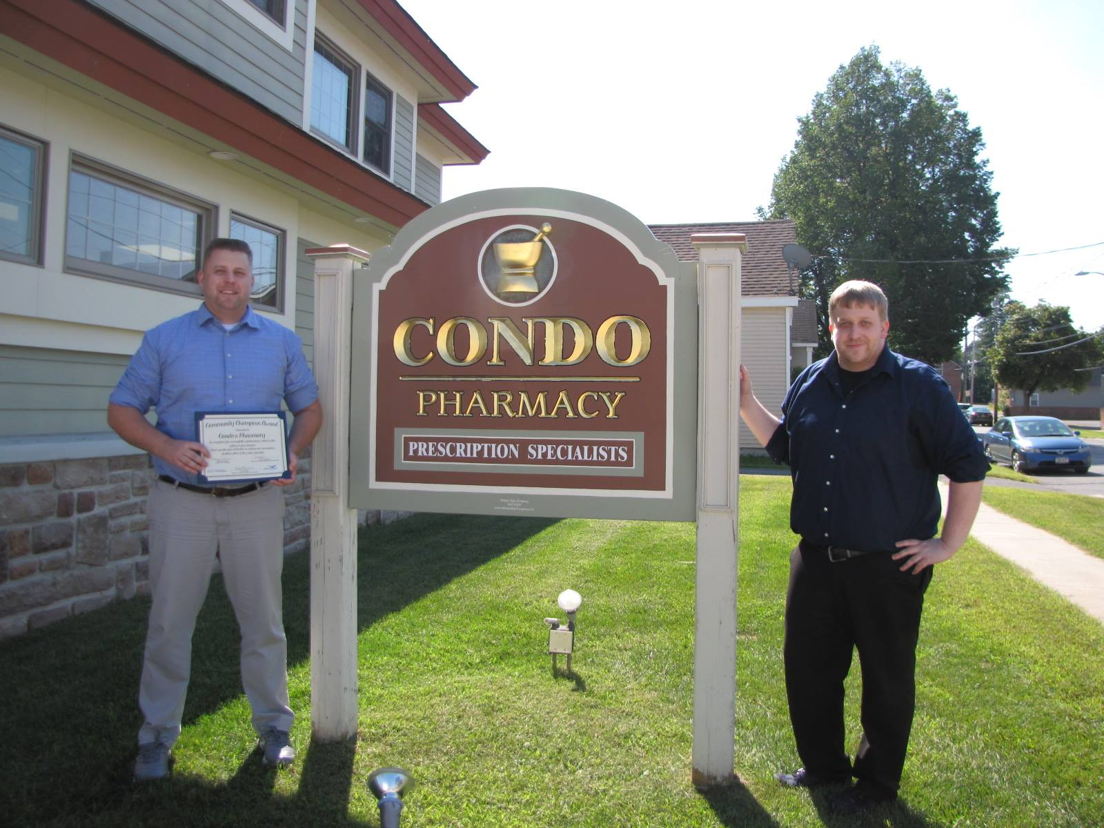 Condo Pharmacy  on Montcalm Avenue in Plattsburgh, NY was the next installment of our Community Champion Award in September 2015. We thank them for their efforts to make our community a safe place to live, work, and play. Here's a photo of Steve and Dave Moore with their award!