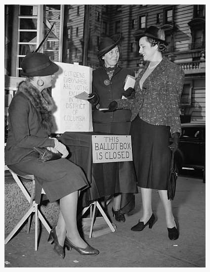 1936 - DC League volunteers set up a closed ballot box to protest the lack of voting in the District of Columbia. (Library of Congress)