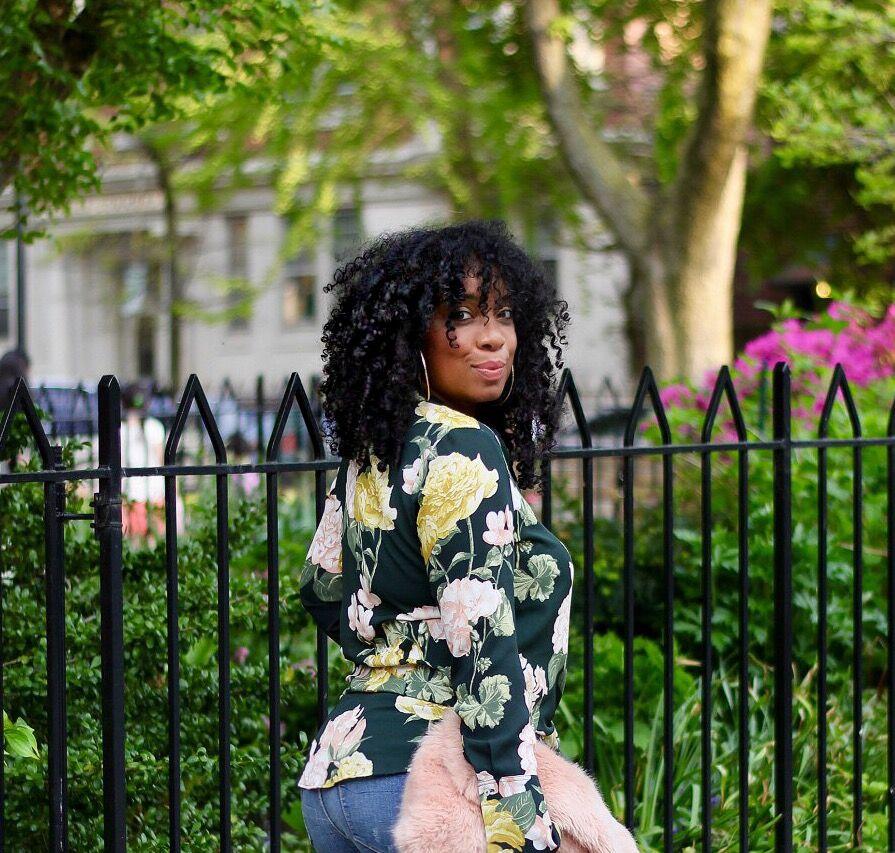 floral blouse and faux fur clutch