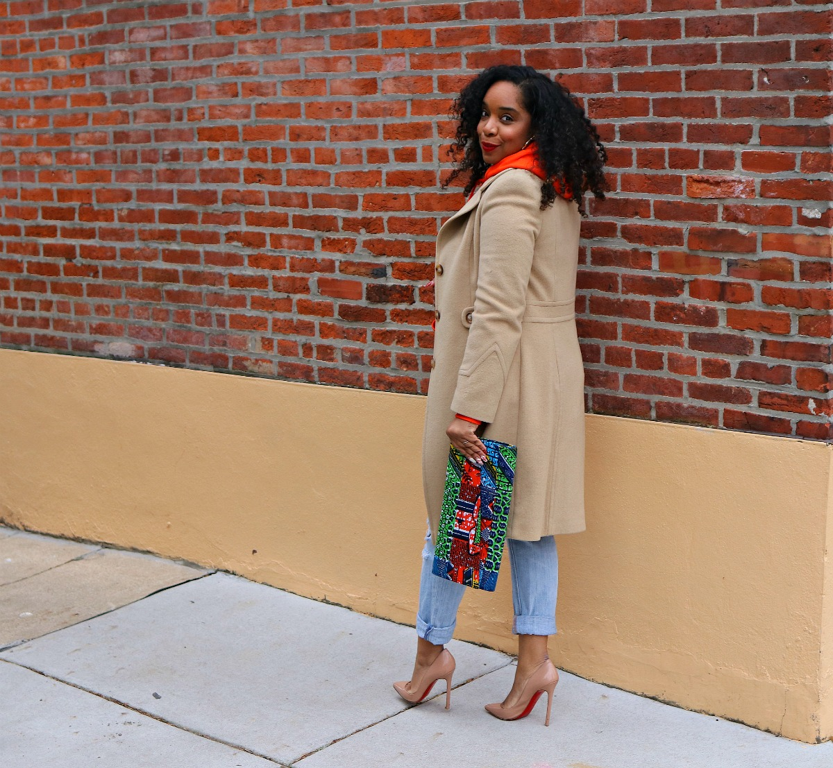 Camel Thrifted coat, Nude pumps, African clutch, orange hoodie