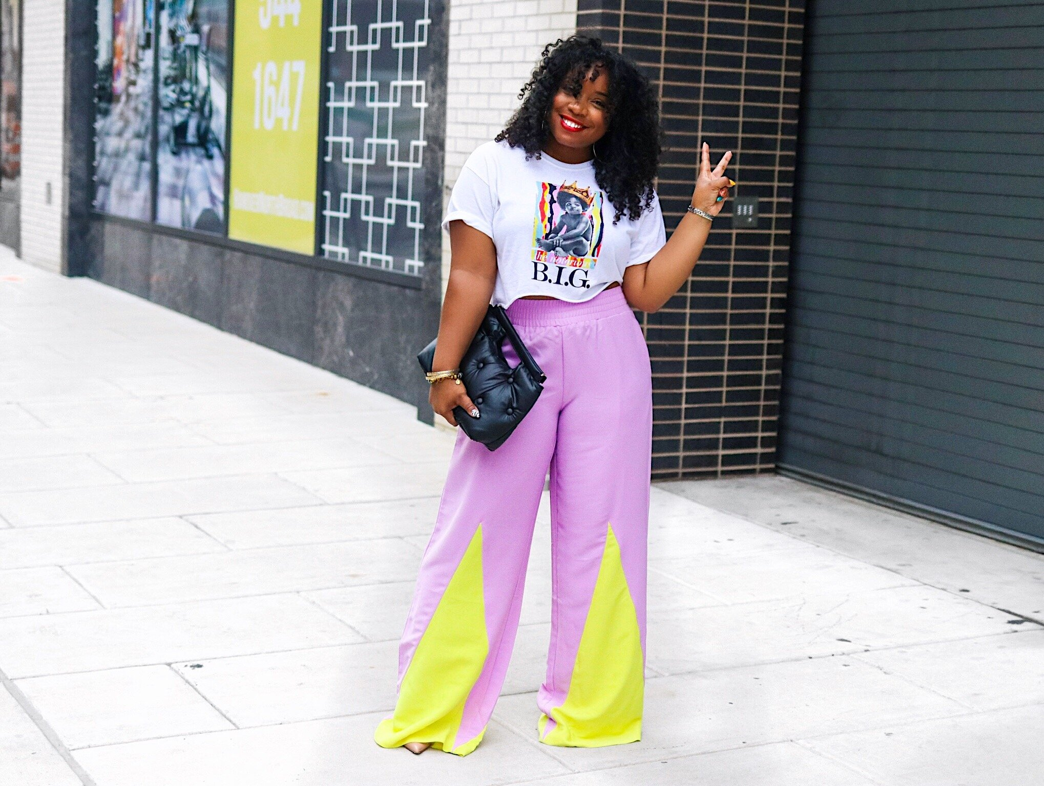 Graphic Biggie Tee, neon trousers, quilted clutch