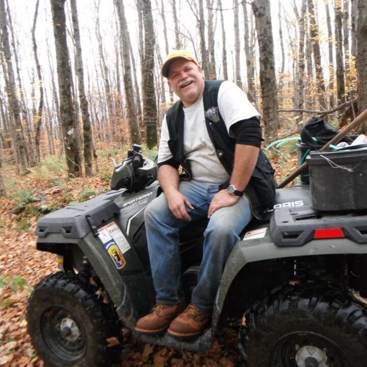 Don Gale on the ATV in the sugar bush