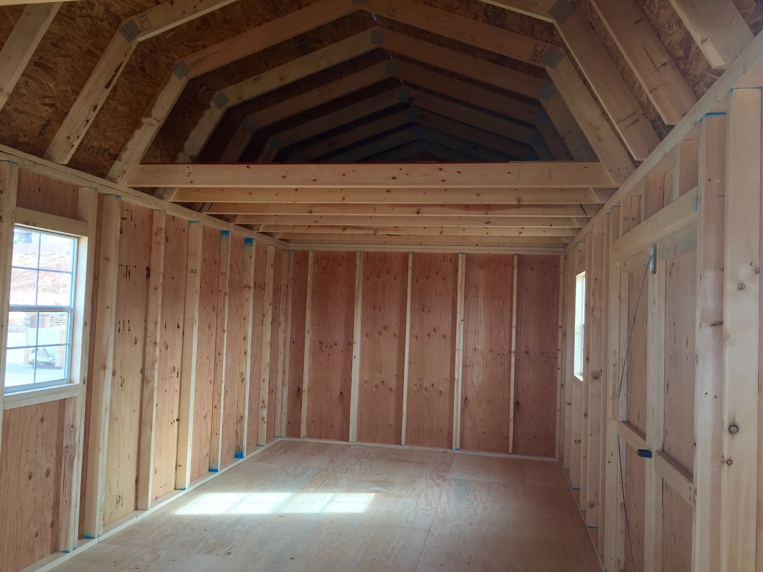 Side Lofted Barns have a double door entry from the side, and comes with 2 lofts.