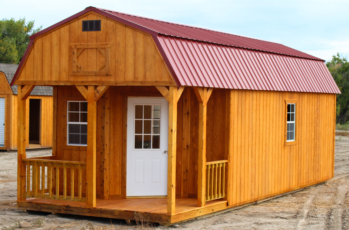 Deluxe Lofted Barn Cabin comes standard with windows, a door, a porch and wood railing. It has Fir Wood siding or LP® SmartSide® painted panels.