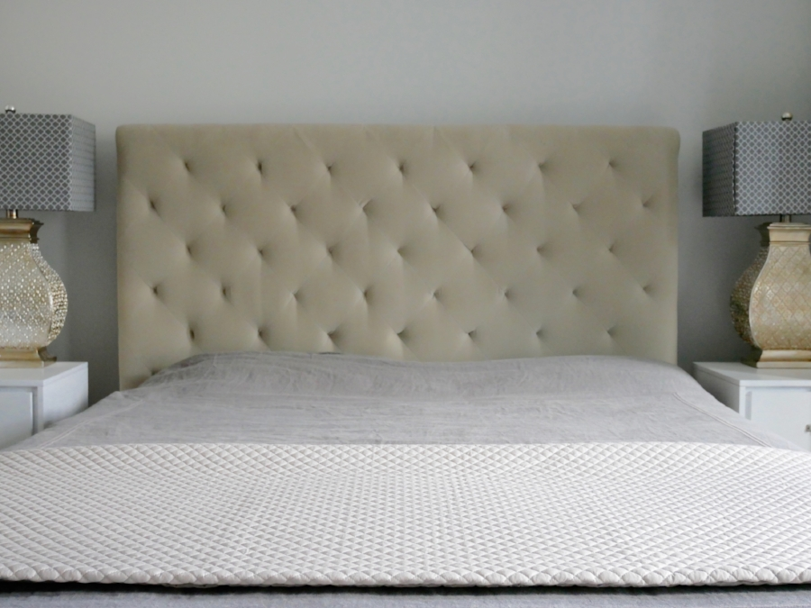 """A nice option for the non-throw pillow guy (or gal) is having a coverlet or quilt laid across the end of the bed. It keeps with the minimalist design, but adds a touch of class. You're saying """"Hey... I know what I'm doing."""" That's a good thing."""