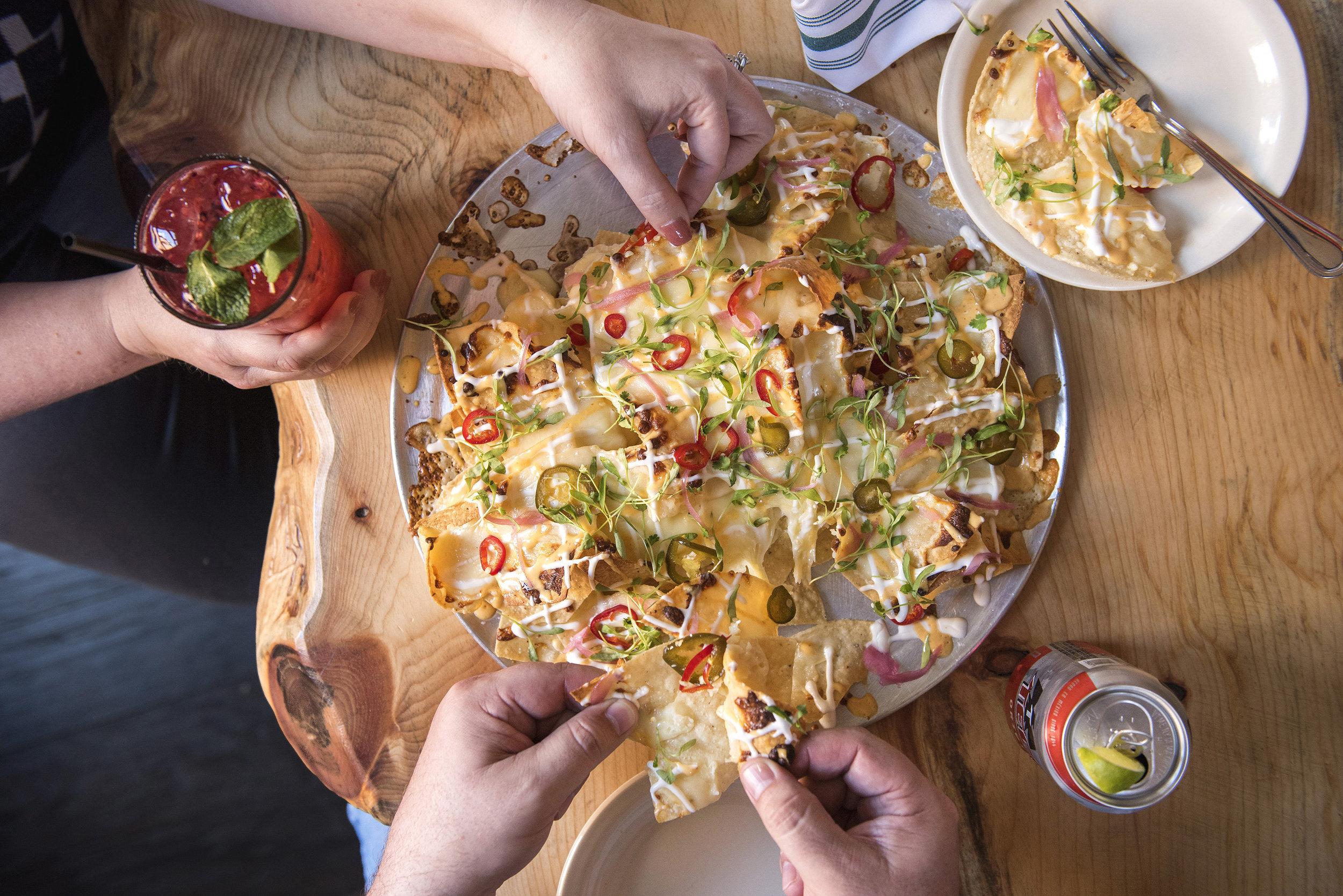 Al Pastor peeling apart nachos.jpg