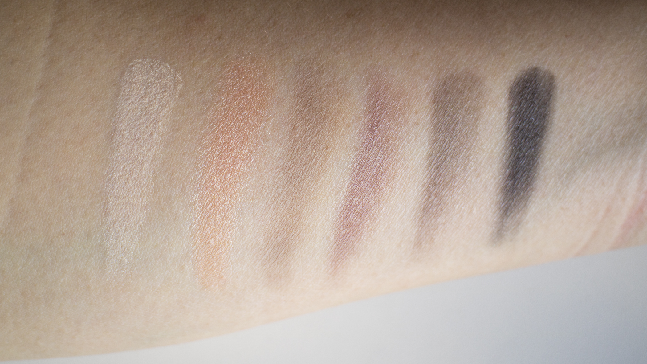 The Legacy Palette Eyeshadow Swatches Bottom Row (From L to R): Beige, Peach, Light Grey, Pewter, Espresso, Black