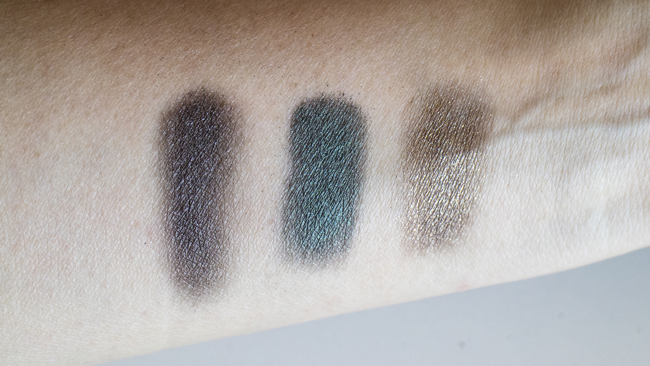 Brush swatches over eye primer - from L: Black Myrrh, Charred Emerald, Bitter Clove