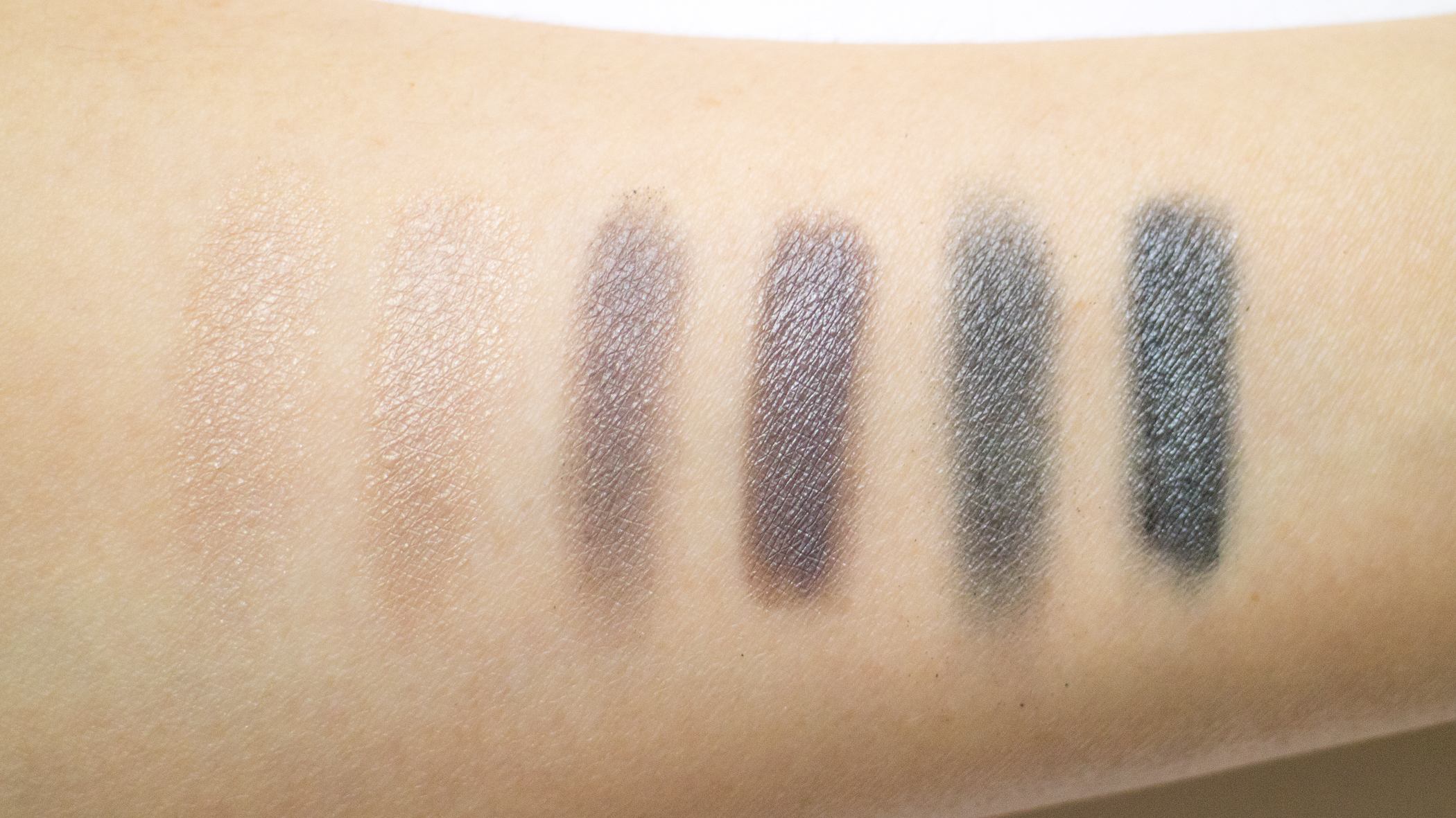 Top Row of shadows, each color swatched onto primer - dry on the left, and wet on the right.