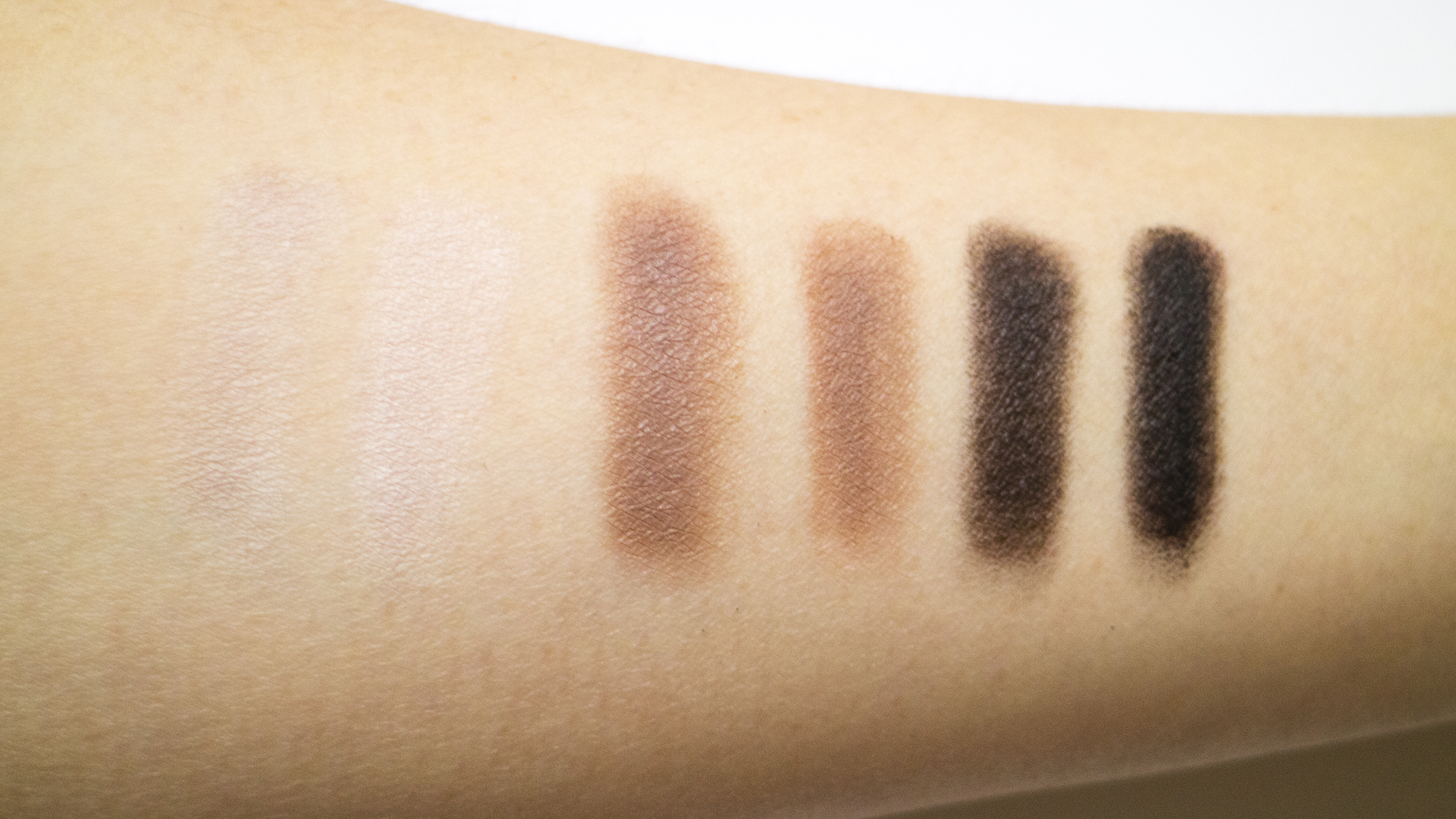 Bottom Row of shadows, each color swatched onto primer - dry on the left, and wet on the right.