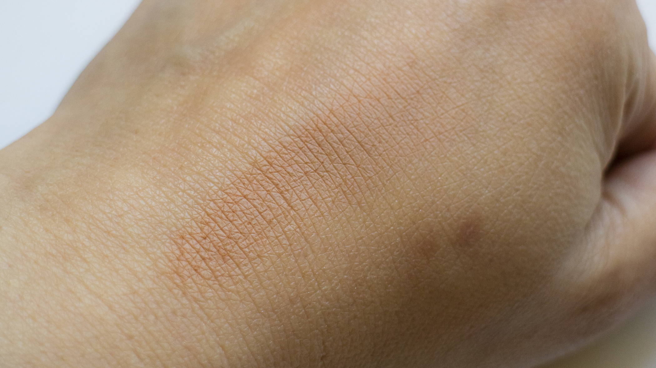Marc Jacobs O!Mega Bronzer in Tantric 102 finger swatched.