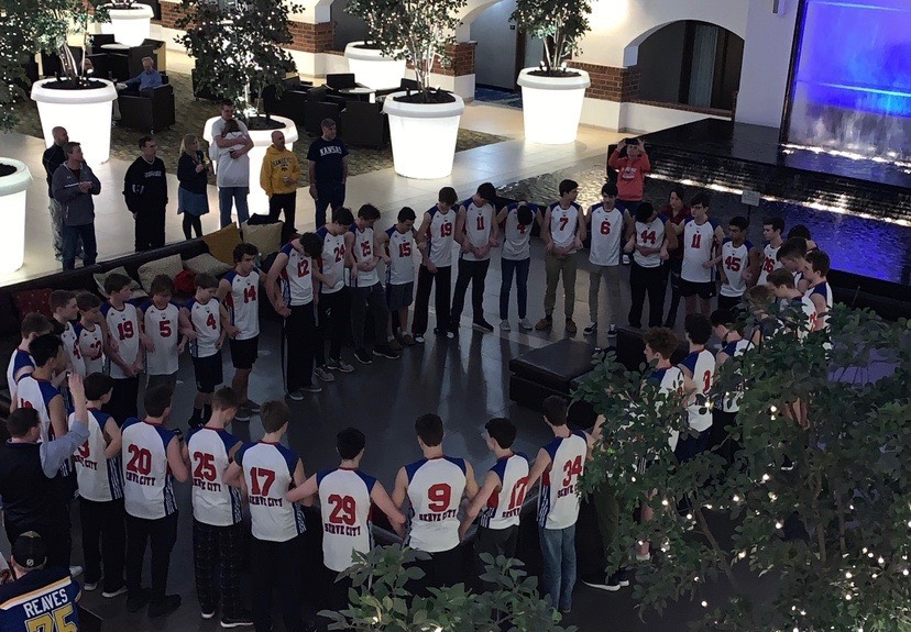 Serve City boys volleyball players gather during a tournament on Sunday for an 18-second moment of silence in memory of Beth Dunlap.