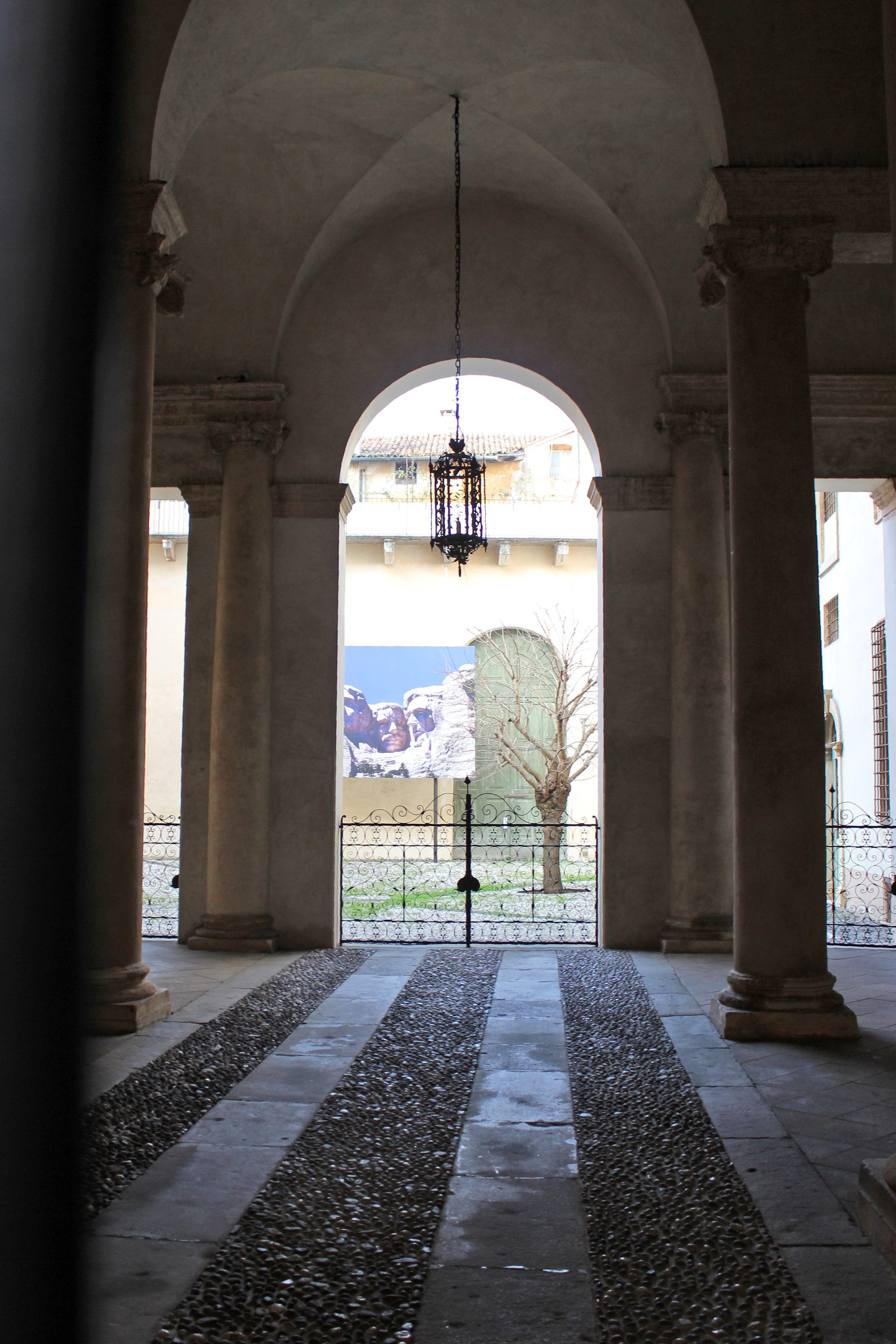 Entering the Palladio Museum with a giant image of Mount Rushmore in the courtyard.