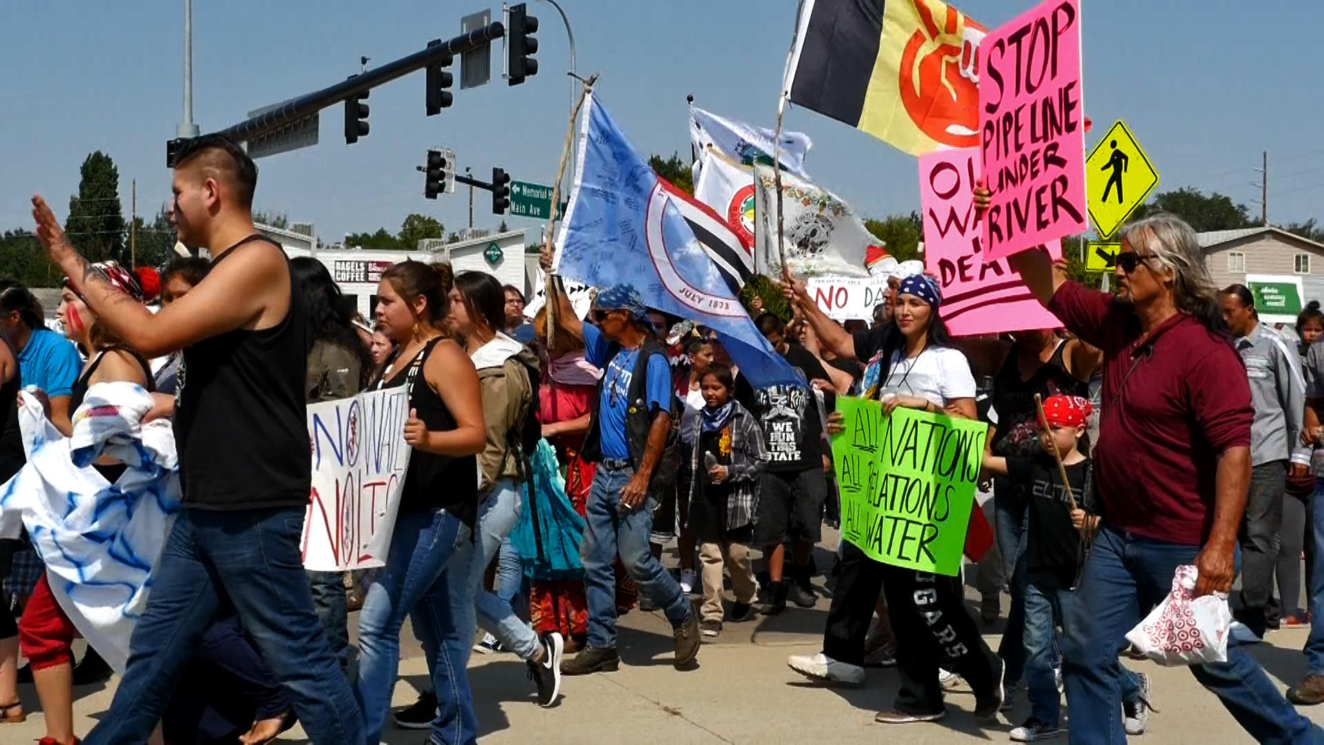 #NoDAPL protestors near the Memorial Bridge in Bismarck, ND. Photo by Mike Glatt.