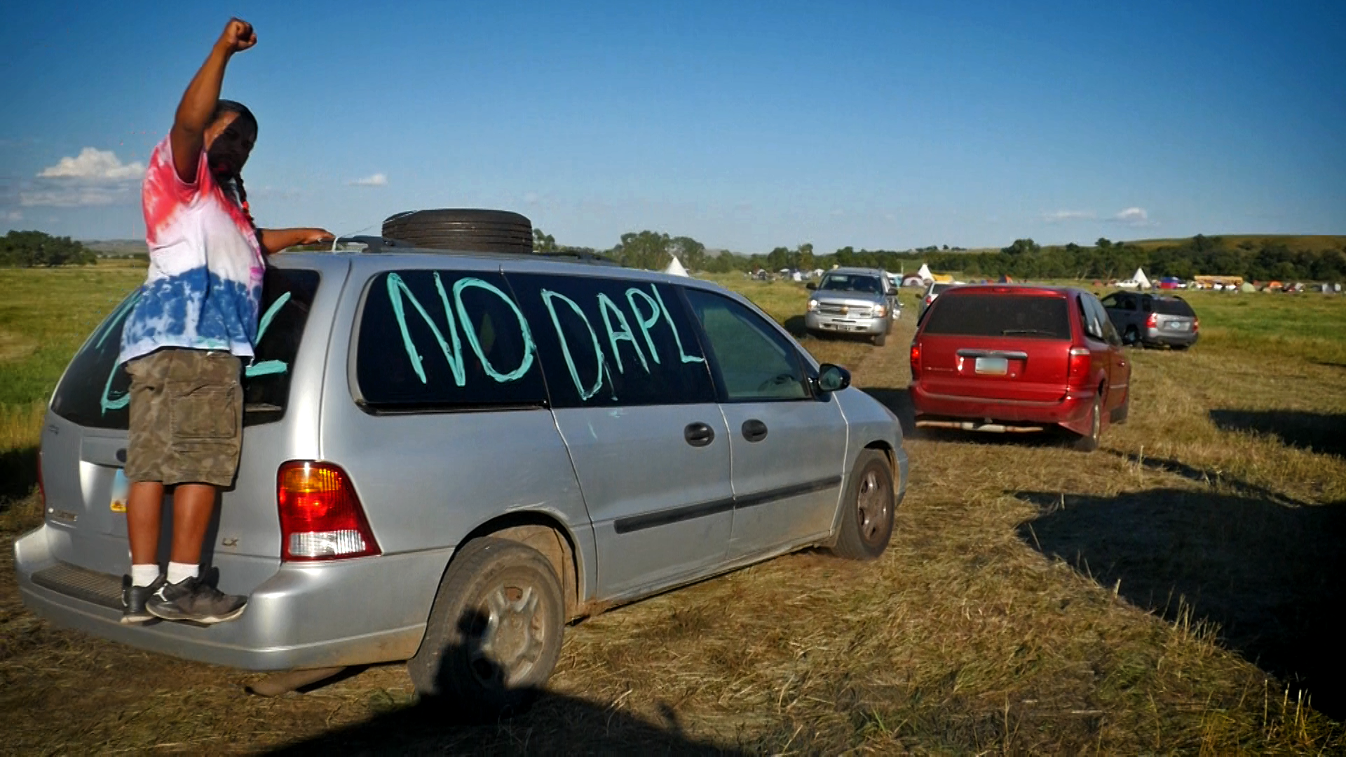 #NoDAPL written on the side of a van in the Sacred Stone Camp in Standing Rock. Photo by David Swenson.