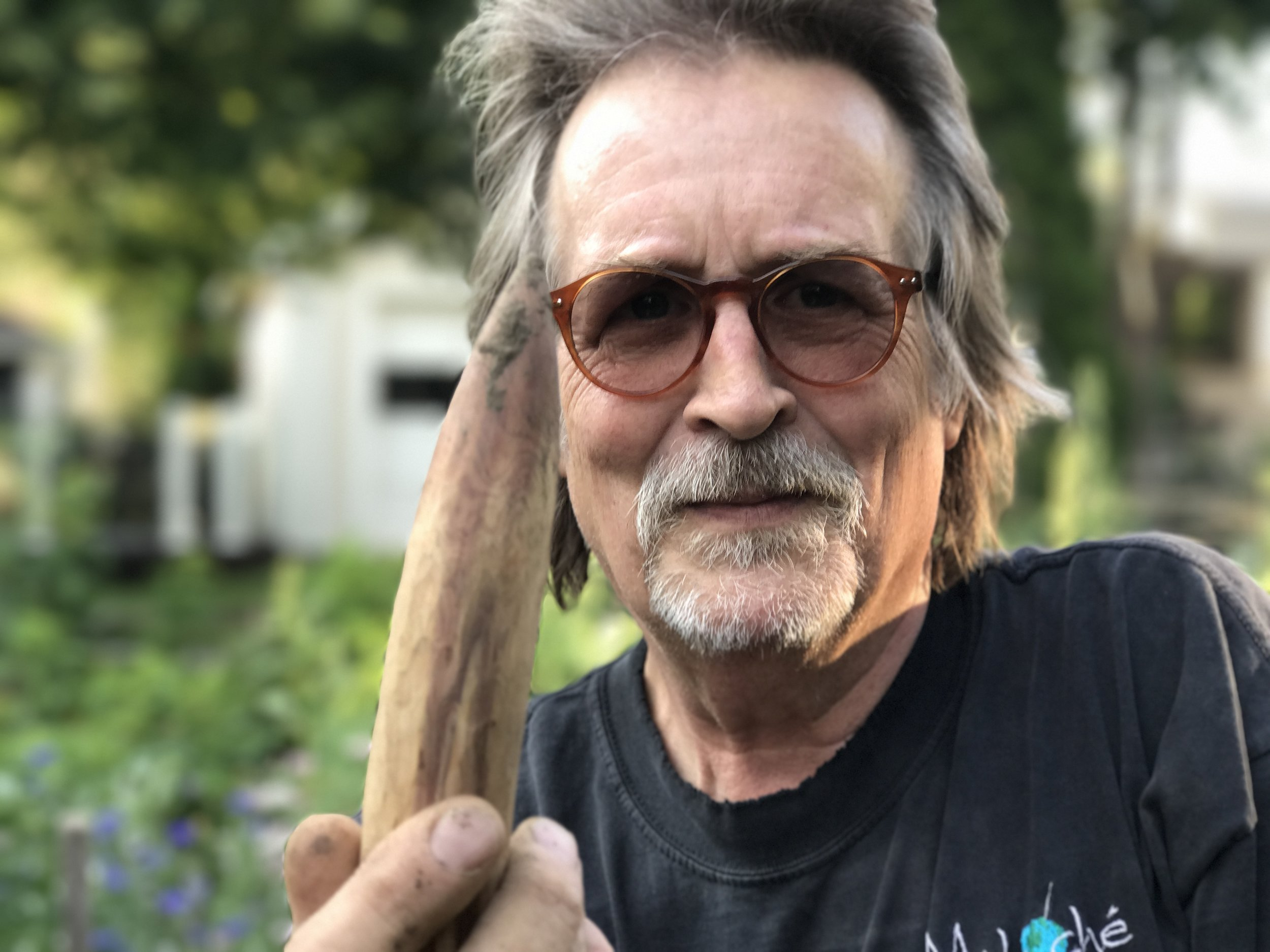 David Swenson in his garden with his dibble.