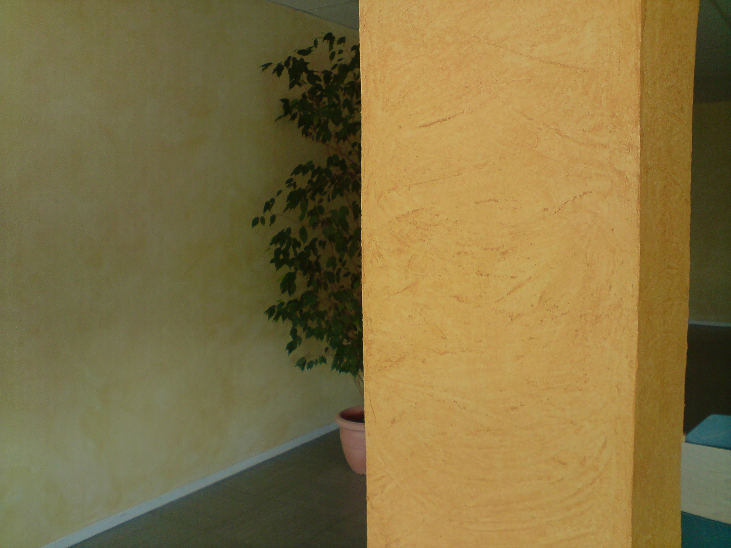 Wallpaper textured then painted on walls and columns.
