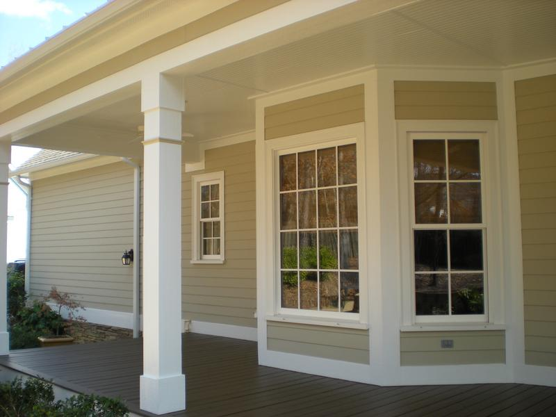 Exterior painting project of the new siding, deck floor, and trim with accent colors.