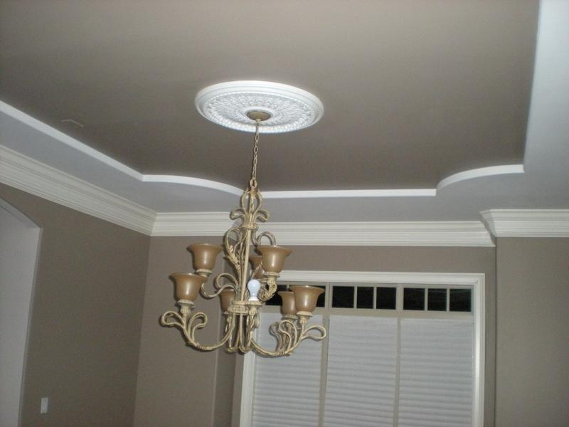 Interior painting of large master bedroom with ceiling to match accent walls.
