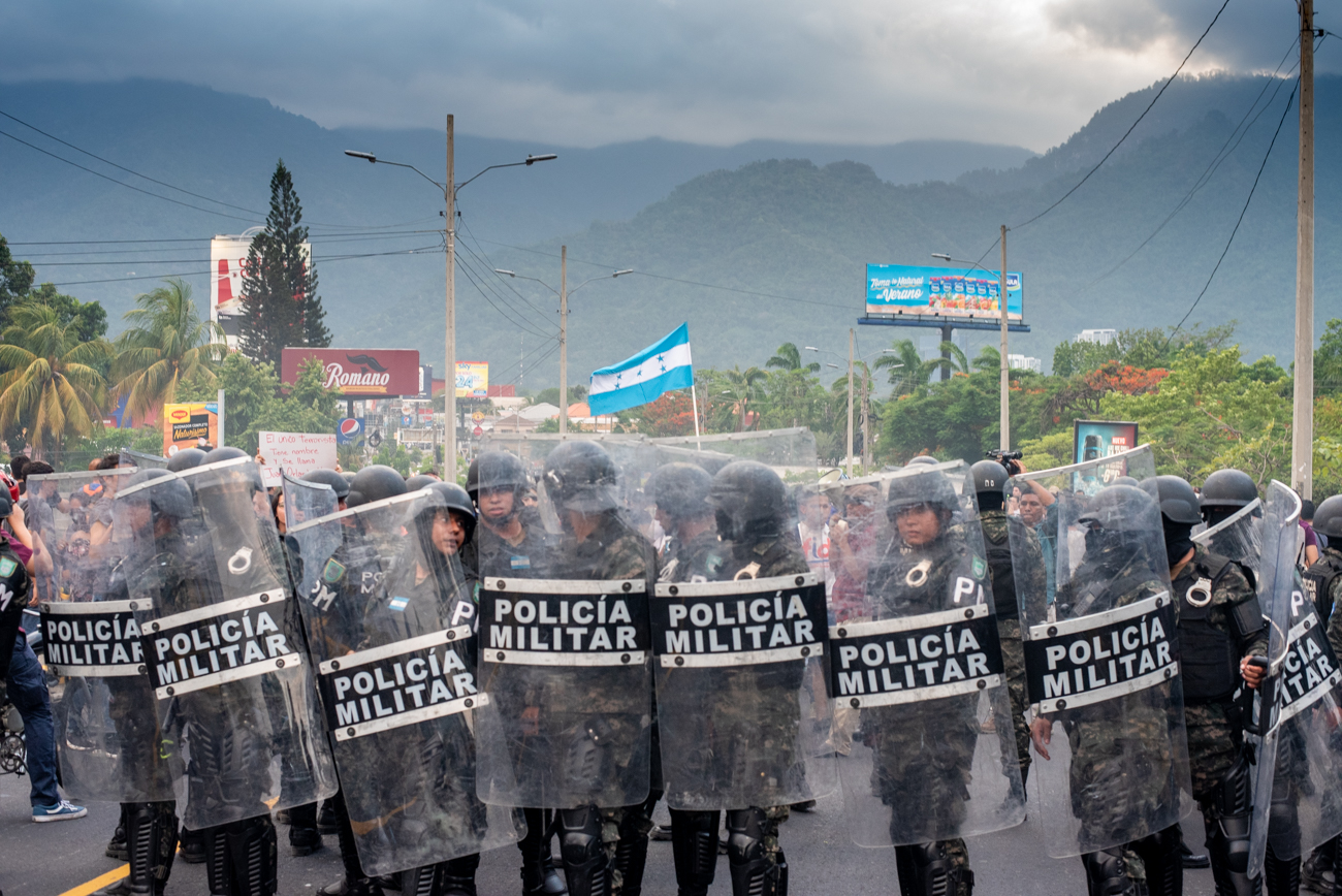Miltary Police attempt to stop student protestors in San Pedro Sula, Honduras. Despite heated face-to-face confrontations, violence was kept to a minimum, tear gas was only thrown once. Students and citizens alike plan to continue protesting until the government dismisses any and all legislation to privatize education and health sectors.