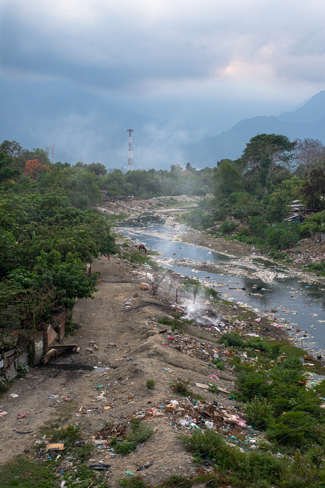 """Sadly, this is the state of many river systems inside populated areas of Honduras. Trash dumping is a rampant issue, that doesn't seem to be improving, especially along the rivers where the country's poorest people live in makeshift shanties, what locals call """"Los Bordos""""--The Edge."""