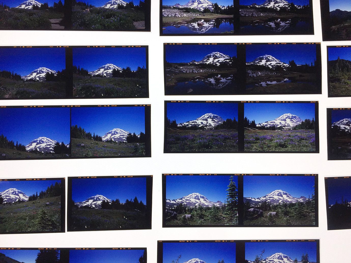 """I had a group of 14 duo pics of Mt. Rainier from a photo shoot in 2017 that I started working with. Here you see a bunch of groupings of """"nearly"""" identical duos of photos of the mountain, each similar, but in some small way different. There's a very cool series of mountain worship pieces coming out of the studio soon!"""