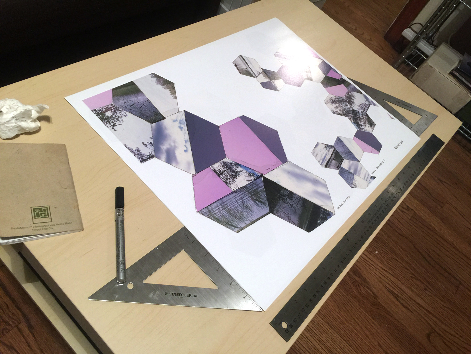 Signing and framing the prints.