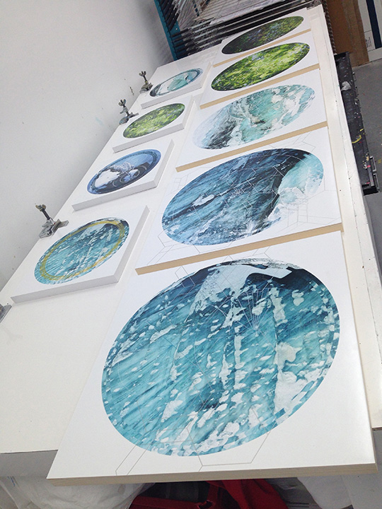 Photos mounted on wood panels