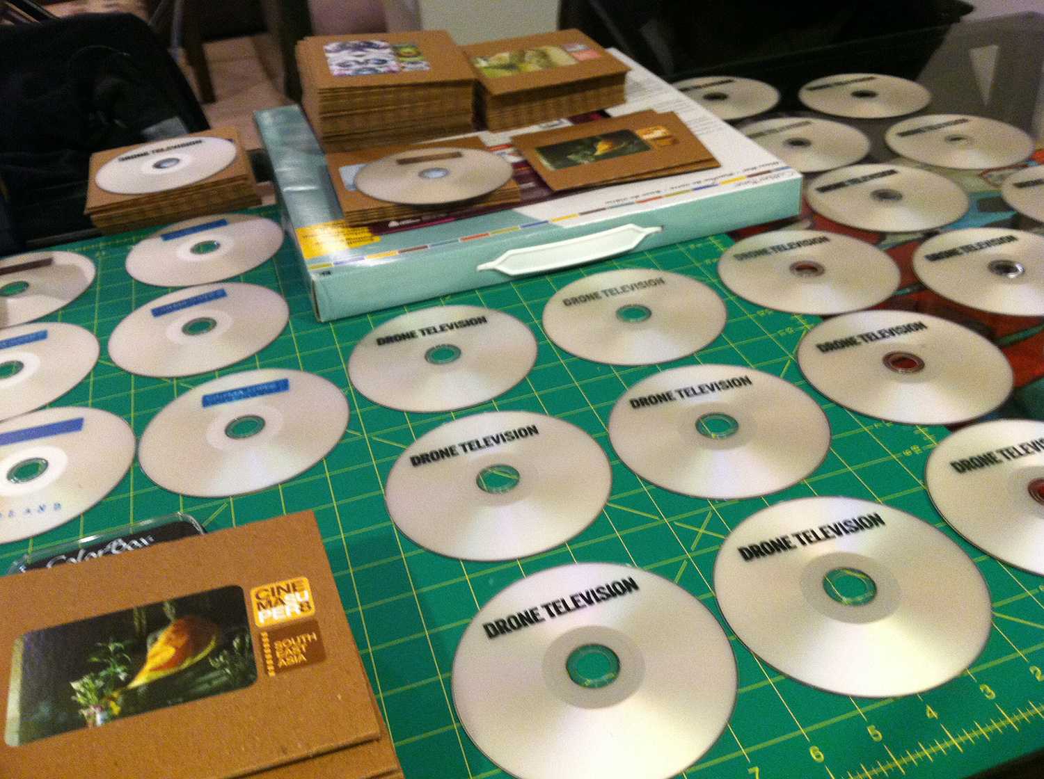 The DVD production line for Drone TV and Cinema Super 8; hand-stamped DVDs drying.