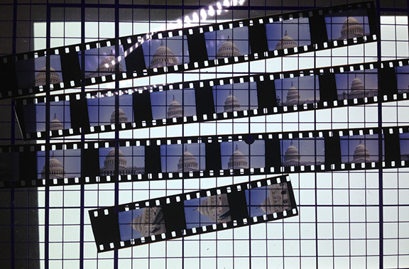 16mm film shot on the Mundus, processed and reviewed on my light table. These sections of the roll were used in the Washington DC Cutup series and were shot holding the camera sideways to get a horizontal image. The frame exposed in the Mundus is a vertical frame.