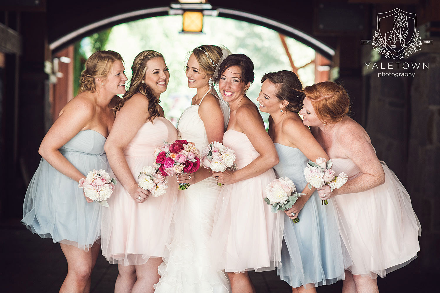 Just adored the soft pink and blue hues of the bridesmaids' dresses, which were the perfect Pantone colours for weddings this past season.