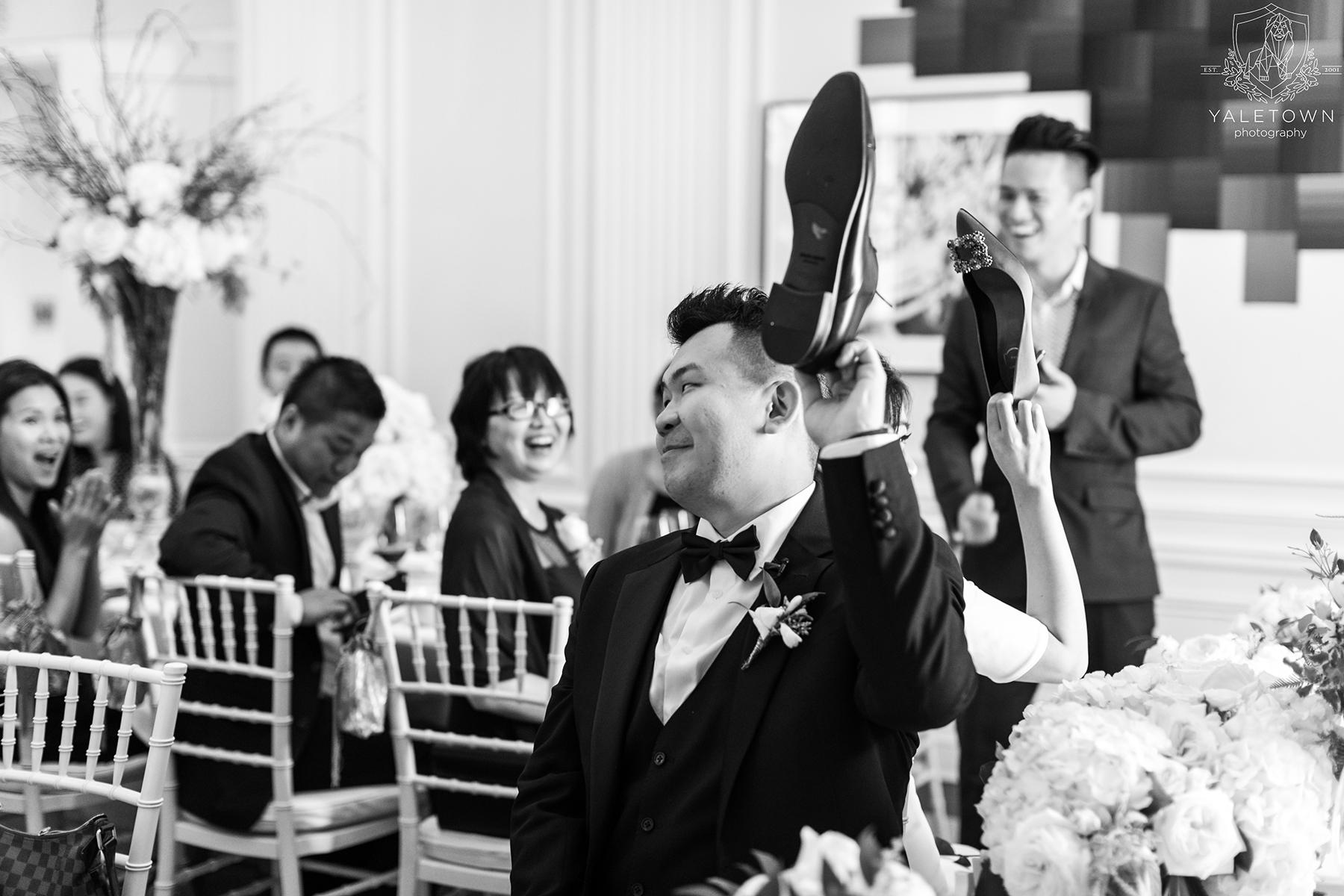 Wedding-Reception-Bride-Groom-Shoe-Game-Rosewood-Hotel-Georgia-Vancouver-Wedding-Yaletown-Photography-photo