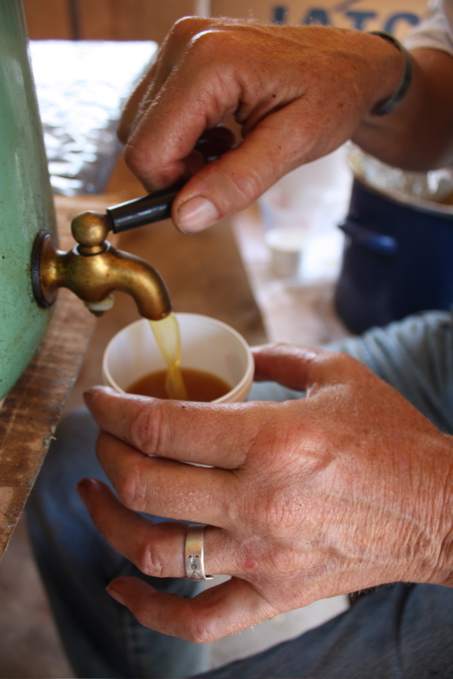 Lee pouring a batch of salve. Photo by Joe Bennion
