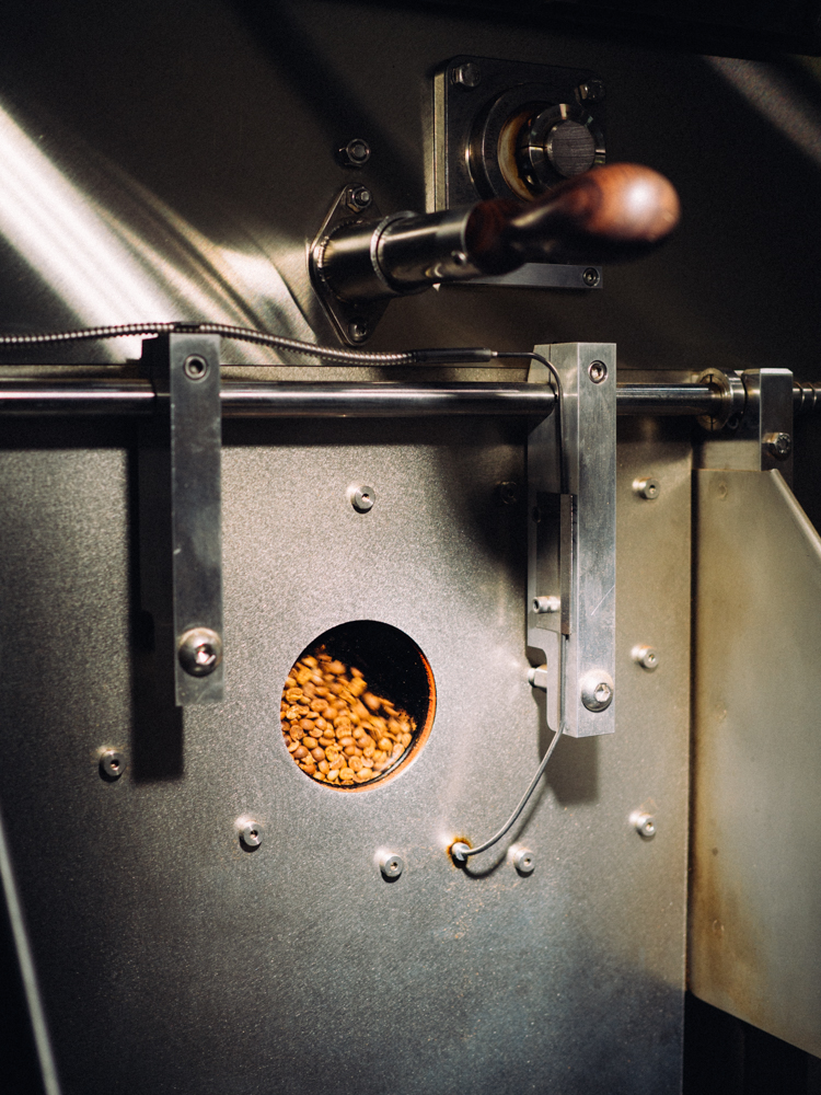 Mid roast, the beans start to turn that familiar brown hue