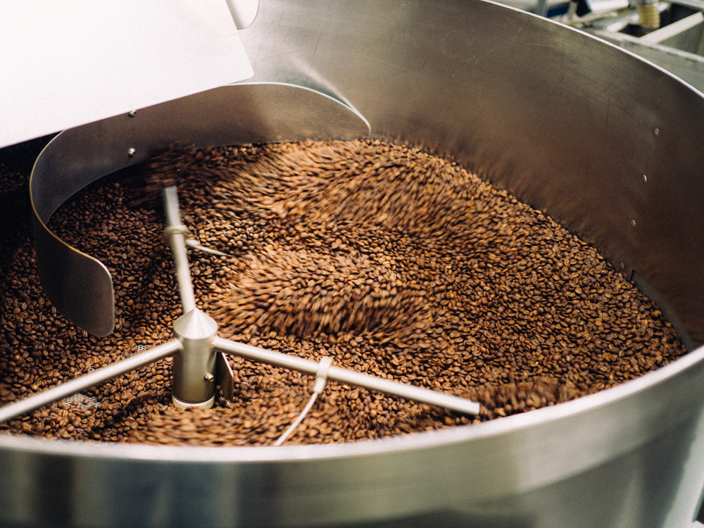 Beans are removed from the roaster and stirred to help the cooling process.