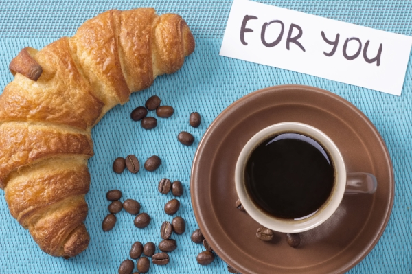 Croissant and coffee on the table. Morning french breakfast special for You.
