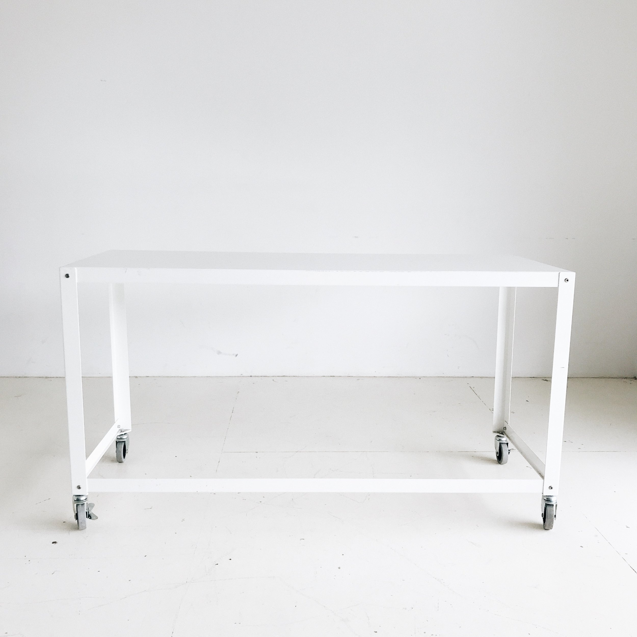 "(2) White Rolling Tables (55""x21"")   Price: $45 each or $75 for both"