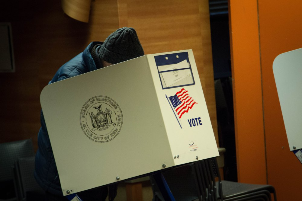 Election Day 2012: A man casts his vote at a polling station.