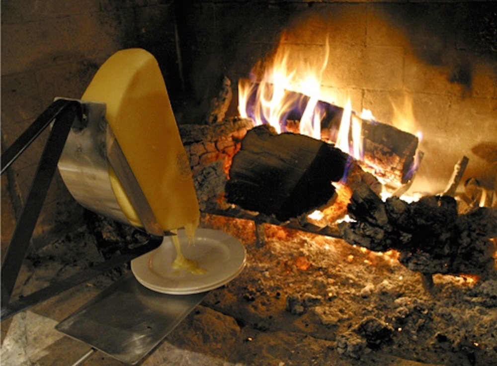 Raclette Prepared The Old-Fashioned Way, Directly Next To The Flames