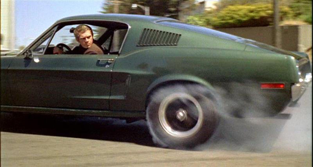 Steve McQueen Lights Them Up Somewhere In SF. What Is It With The Green Cars?