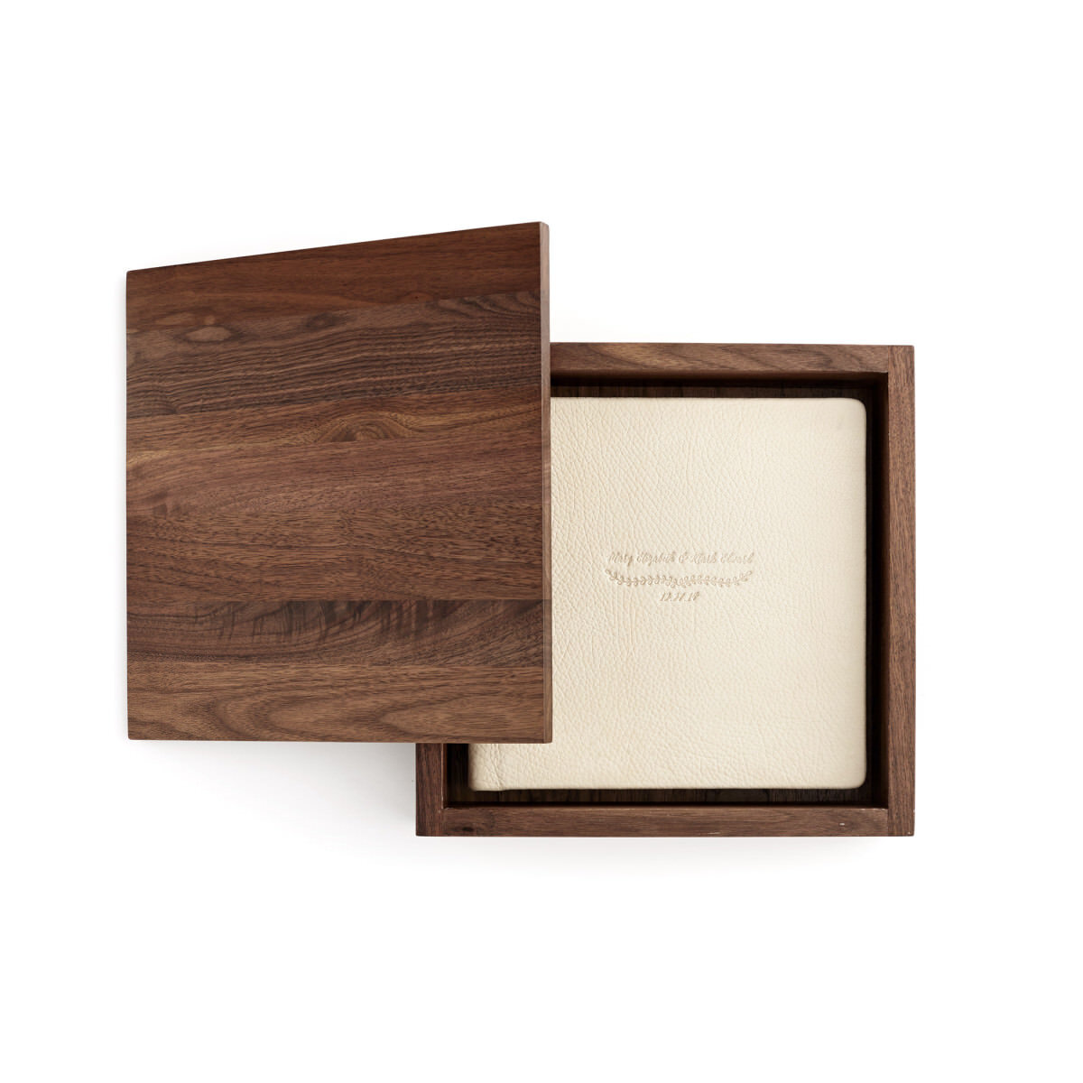 Wooden Album Boxes - These luxurious wooden presentation boxes are the perfect heirloom for storing, protecting, and showcasing albums. They are handcrafted from bamboo or walnut with various stain choices and a smooth, clean finish.• Choose from three walnut stains• Bamboo is available in natural and carbonized finishes• Lid engraving is available.