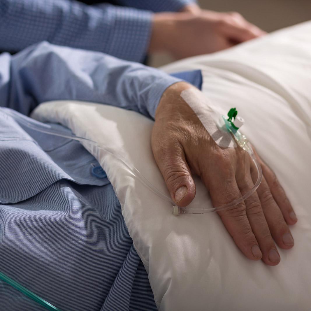 A man lies ill in hospital