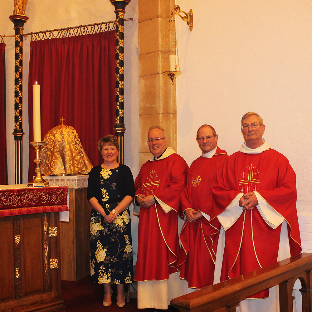 Elaine Fisher, Archdeacon Christopher, Fr Mark and Fr John with the new tabernacle