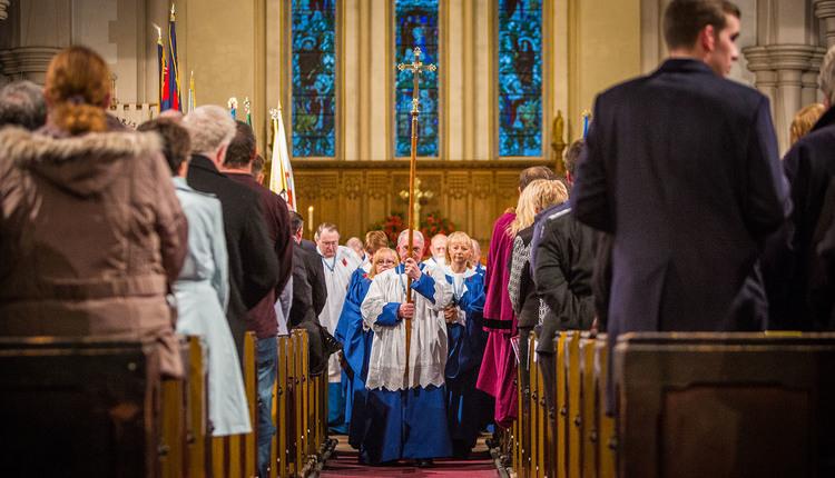 The choir processes in St David's church