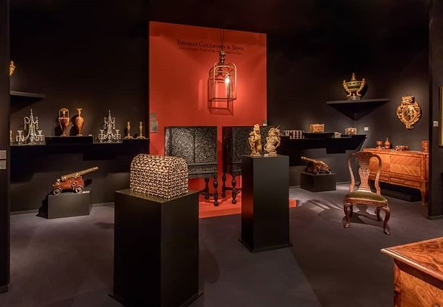 Thomas Coulborn & Sons at Masterpiece Fair 2019.  The striking orange wall makes a comeback this year to contrast the beautiful cabinets displayed in front. Steel squared zig zag shelving give different heights to the objects for a more interesting journey for the viewer.  Amazing objects all around, especially the central heraldic supporters in form of unicorn and lion.  #4dprojects #thomascoulborn #antiques #display #exhibition #masterpiece2019 #orange